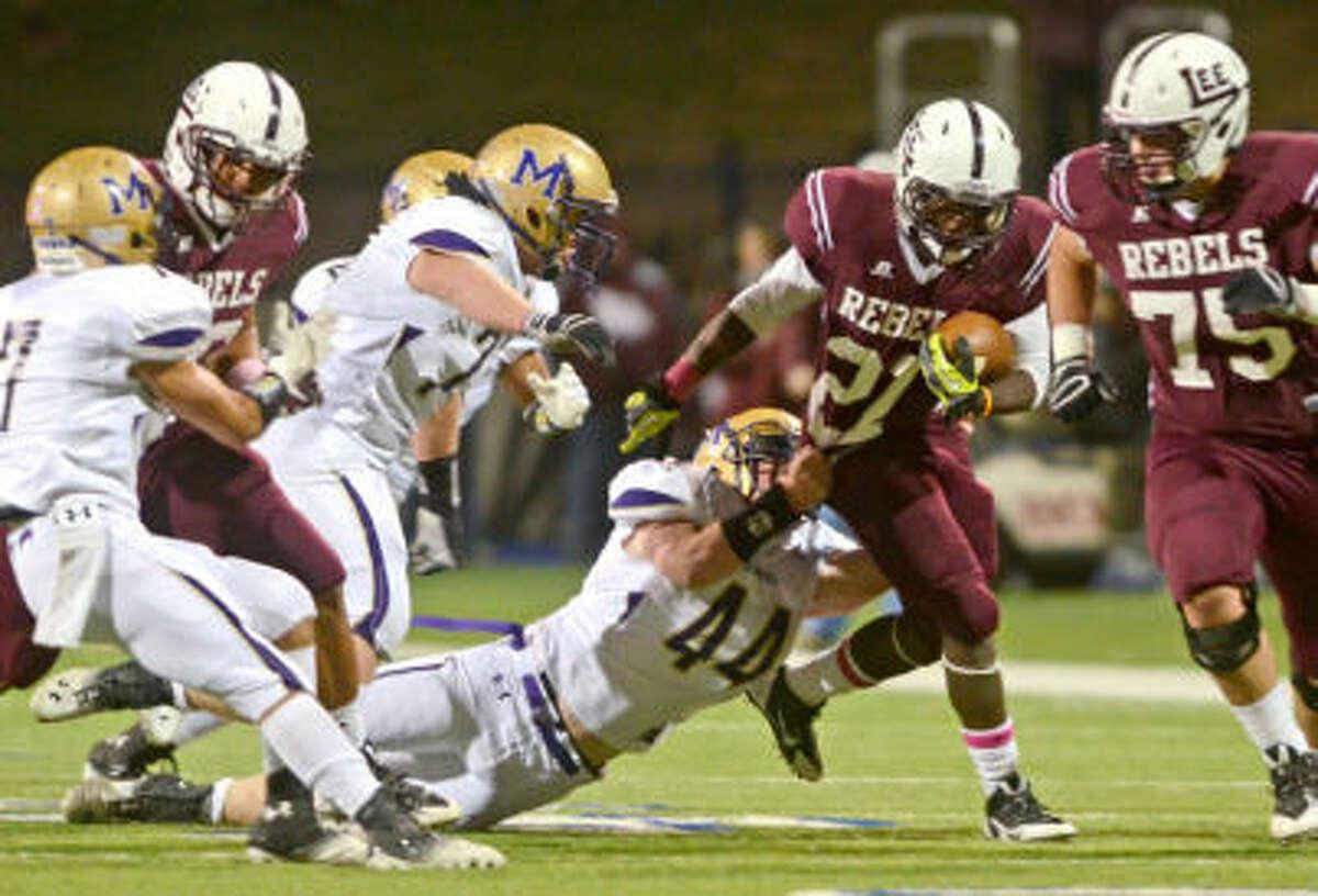 Midland High's Mason Montgomery (44) tries to bring down Lee's Aron Dobbins (21) on Friday at Grande Communications Stadium. James Durbin/Reporter-Telegram