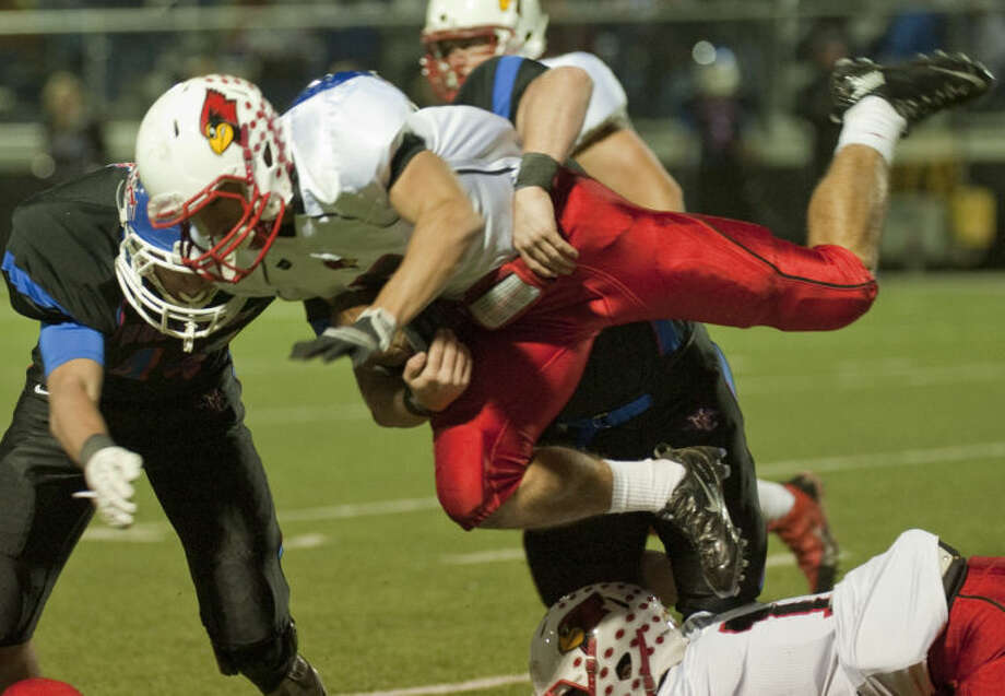 Fort Worth Christian's Jack Robersongets upended and stopped by Midland Christian defenders Friday at Mustang Field. Tim Fischer\Reporter-Telegram Photo: Tim Fischer