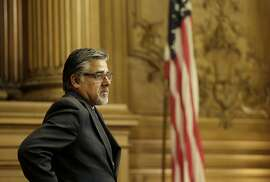 Supervisor John Avalos stands during a Board of Supervisors meeting at City Hall in San Francisco, Tuesday, May 10, 2016. The Board of Supervisors plans to vote on May 24 on whether to reaffirm its strict protections and spell out when immigrants can be turned over to the U.S. government, nearly a year after a shooting death along a San Francisco pier sparked a national debate on how the city handles immigrants in the U.S. illegally. (AP Photo/Jeff Chiu)