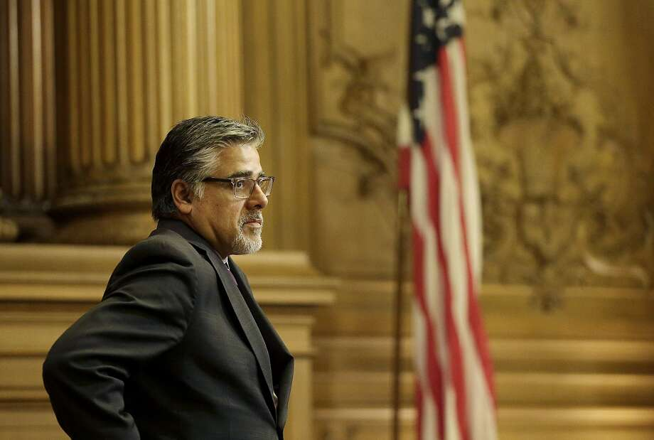 Supervisor John Avalos stands during a Board of Supervisors meeting at City Hall in San Francisco, Tuesday, May 10, 2016. The Board of Supervisors voted to put a charter amendment on the November ballot to lower the voting age to 16 in city elections. (AP Photo/Jeff Chiu) Photo: Jeff Chiu, Associated Press