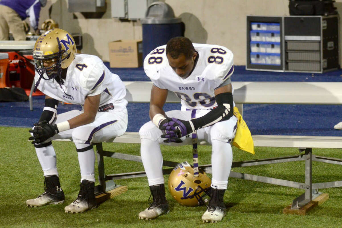 Midland High wide receivers DeAndre Goodley (4) and Mazelle Justice (88) react on the sidelines in the final minute of play against Lee on Friday at Grande Communications Stadium. Lee beat Midland 34-28. James Durbin/Reporter-Telegram