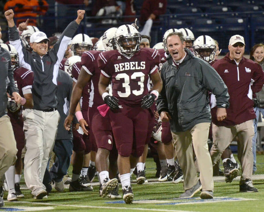 The Lee football team hadn't played a postseason game in three years, and the questions surrounding the program were numerous.But when the 2013 season ended, the Rebels had not only returned to the playoffs but shared its first district title since 2000, and quarterback Caden Coots broke nearly every passing record in the record book.The Rebels finished the season at 9-3, with two losses coming to Southlake Carroll and the other San Angelo Central, which the Rebels shared the District 2-5A title.Meanwhile, Coots started one year at quarterback but will hold nearly every major passing record at Lee as the Rebels utlized new offensive coordinator's Cliff Watkins spread offense this season.Coots set passing records for yards in a season, yards in a game and will leave as the school's career leader in passing yards with his 3,398 this season. Coots also threw 34 touchdown passes this season, also a record. Photo: JAMES DURBIN