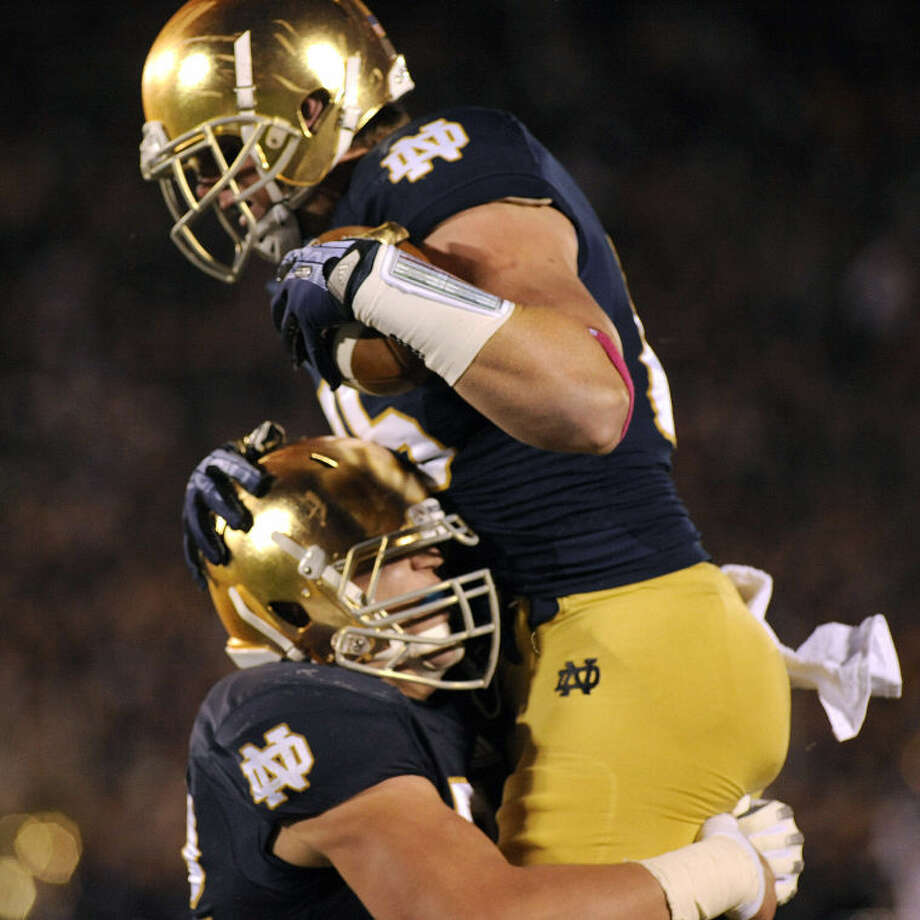 Notre Dame tight end Troy Niklas, right, celebrates with teammate Nick Martin after a Niklas' catch resulted in a touchdown pass during the first quarter of a college football game Saturday, Oct. 19, 2013, in South Bend, Ind. (AP Photo/Joe Raymond) Photo: Joe Raymond