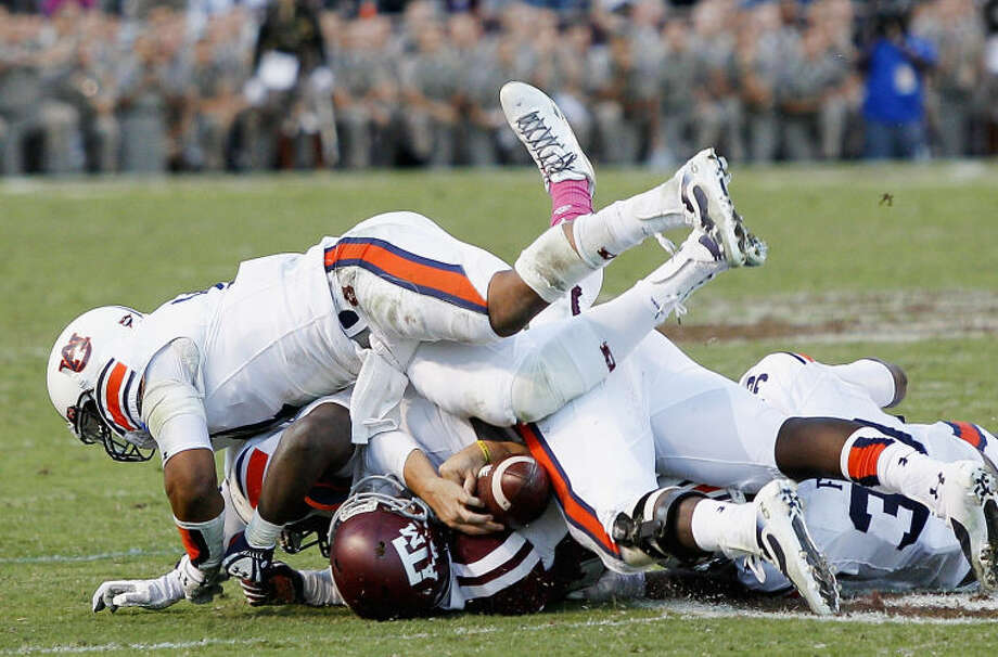 Texas A&M quarterback Johnny Manziel (2) is sacked by Auburn in the fourth quarter of an NCAA college football game Saturday, Oct. 19, 2013, in College Station, Texas. Auburn won 45-41. (AP Photo/Bob Levey) Photo: BOB LEVEY
