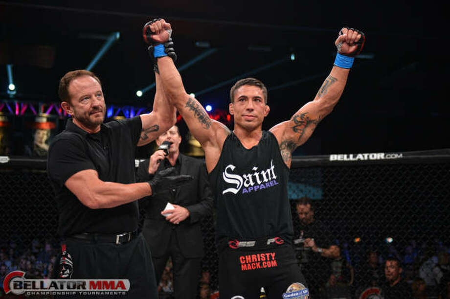 Kerry Hatley, left, raises the arm of a Mixed Martial Arts fighter during a Bellator fight card recently. Hatley lives in Midland and has been refereeing at major MMA bouts for more than a decade.Photo courtesy of Bellator MMA