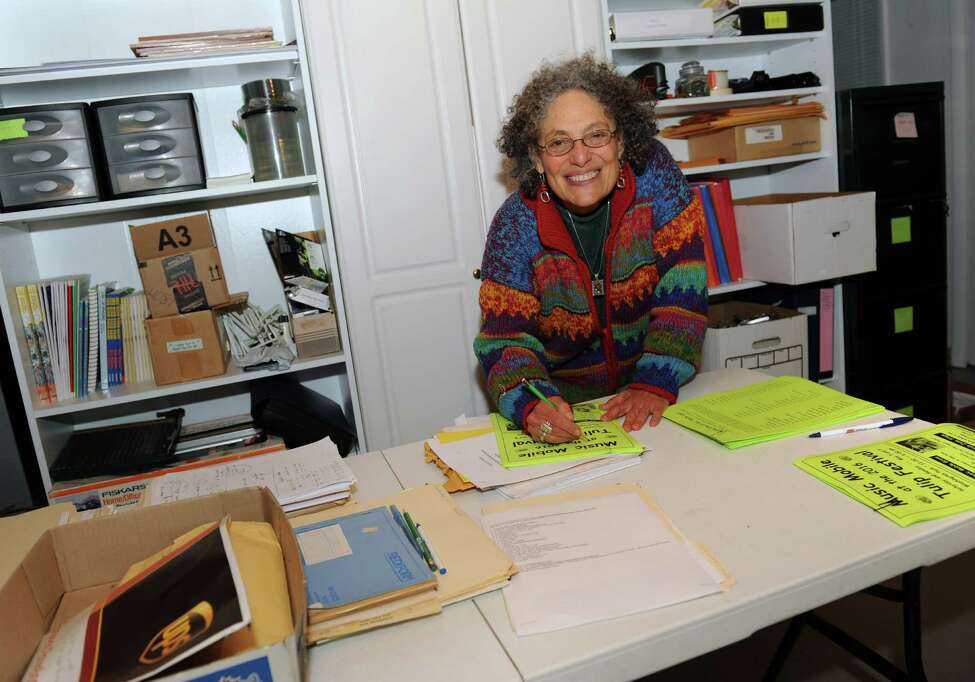 Ruth Pelham, who ran the Music Mobile for 39 year, works on flyers for the Tulip Festival in her home on Wednesday, May 4, 2016 in Albany N.Y. (Lori Van Buren / Times Union)