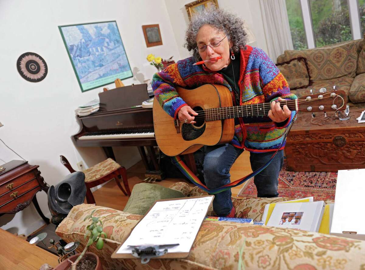 Ruth Pelham, who ran the Music Mobile for 39 years, works on a new song in her home on Wednesday, May 4, 2016 in Albany N.Y. (Lori Van Buren / Times Union)