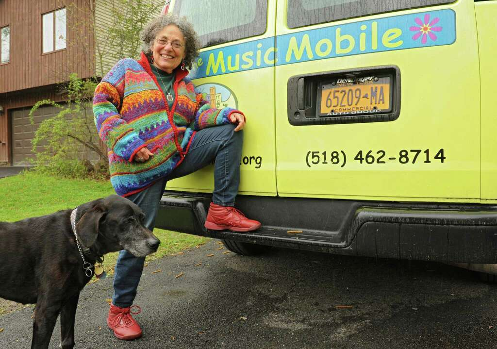 Ruth Pelham, who ran the Music Mobile for 39 years, stands by The Music Mobile van with her dog Bodhi at her home on Wednesday, May 4, 2016 in Albany N.Y. (Lori Van Buren / Times Union) Photo: Lori Van Buren / 20036472A