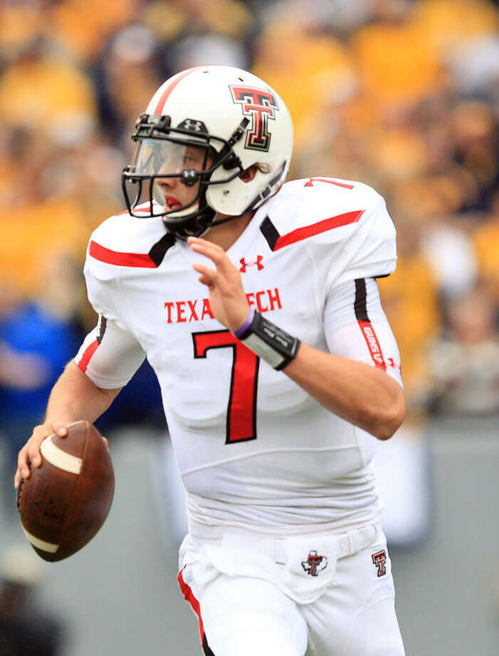 Texas Tech quarterback Davis Webb (7) rolls from the pocket during the second quarter of their NCAA college football game against West Virginia in Morgantown, W.Va., on Saturday, Oct. 19, 2013. (AP Photo/Chris Jackson) Photo: Chris Jackson
