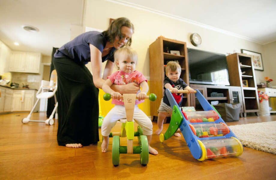 Brooke Ellington of Little Sprouts Natural and Organic Daycare plays with 17-month-old Brooklyn Looney and 10-month-old Boone Ellington on Sept. 24. James Durbin/Reporter-Telegram Photo: JAMES DURBIN