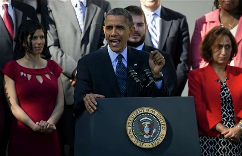 President Barack Obama gestures while speaking in the Rose Garden of the White House in Washington, Monday, Oct. 21, 2013, on the initial rollout of the health care overhaul. Obama acknowledged that the widespread problems with his health care law's rollout are unacceptable, as the administration scrambles to fix the cascade of computer issues. (AP Photo/ Evan Vucci) Photo: Evan Vucci / AP