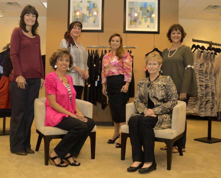 Breast cancer survivors, seated, Maribelle Vigil-Minyard, Ann Bradford, back left, Michelle Johnson, Cori Hyatt, Micaela Gonzales and Mara Barham. Tim Fischer\Reporter-Telegram Photo: Tim Fischer