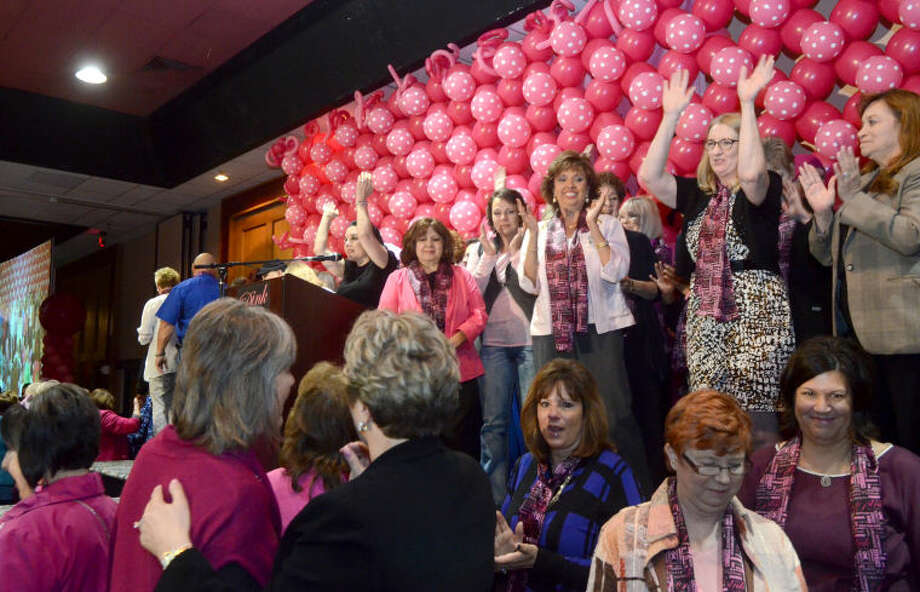 "Geralyn Lucas, author of ""Why I Wore Lipstick To My Mastectomy,"" speaks after inviting breast cancer survivors onto the stage with her during the seventh annual Pink The Basin luncheon at the MCM FunDome. James Durbin/Reporter-Telegram Photo: JAMES DURBIN"