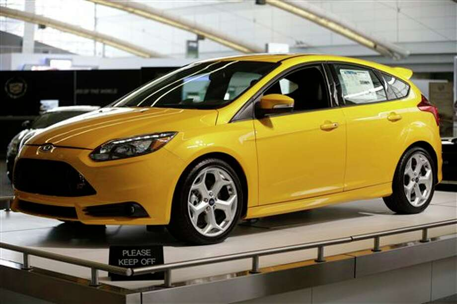 FILE - This file photo taken Feb. 14, 2013 shows the 2013 Ford Focus ST on display at the 2013 Pittsburgh Auto Show in Pittsburgh. Ford on Wednesday, Oct. 23, 2013 claimed the top-selling car in the world crown for its Focus compact during the first half of the year, based on registration data gathered by the R.L. Polk & Co. research firm. (AP Photo/Gene J. Puskar, File) Photo: Gene J. Puskar / AP