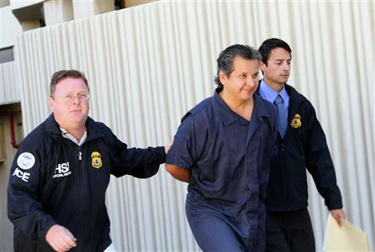 FILE - In this Nov. 5, 2012 file photo, El Paso lawyer and philanthropist Marco Antonio Delgado is escorted out of the El Paso County Jail in El Paso, Texas. Jury selection for the trial of Delgado, who faces charges of conspiring to launder money for a Mexican drug cartel, is scheduled start Monday, Oct. 21, 2013, followed by opening arguments at the federal court in El Paso, Texas. (AP Photo/Juan Carlos Llorca, File)