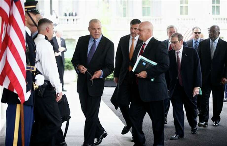 From left, Aetna CEO Mark Bertolini, Humana CEO Bruce Broussard, Blue Cross Blue Shield of Florida CEO Patrick Geraghty, and other health care chief executive officers arrive at the White House in Washington, Wednesday, Oct. 23, 2013, to meet with White House officials regarding President Barack Obama's health care law. (AP Photo/Charles Dharapak) Photo: Charles Dharapak / AP