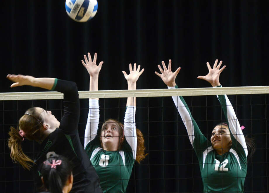 Midland College's Kristina Gafford (8) and Samantha Orta (12) try to block a hit from Clarendon on Wednesday at Chaparral Center. James Durbin/Reporter-Telegram Photo: JAMES DURBIN