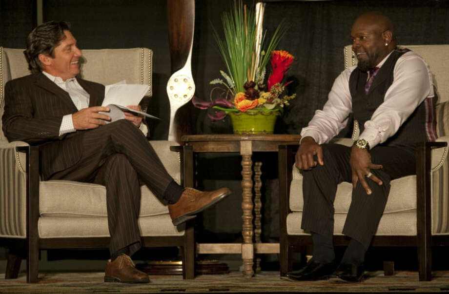 Local TV personality Jay Hendricks talks with former Dallas Cowboy Emmitt Smith Thursday evening during a fundraiser for Opportunity Camp. Tim Fischer\Reporter-Telegram Tim Fischer\Reporter-Telegram Photo: Tim Fischer