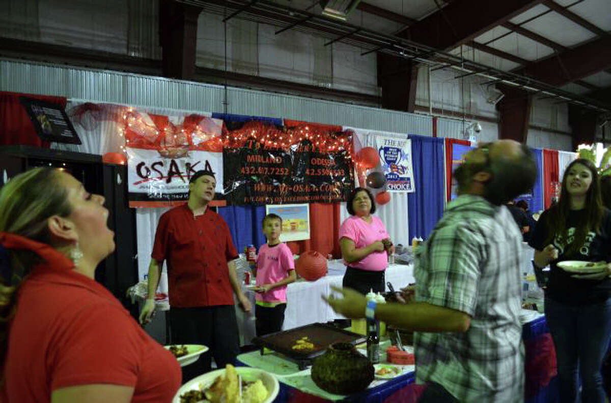 Foodies attempt to catch shrimp at Osaka's booth at the 2013 Taste of the Permian Basin at the CAF Thursday night.