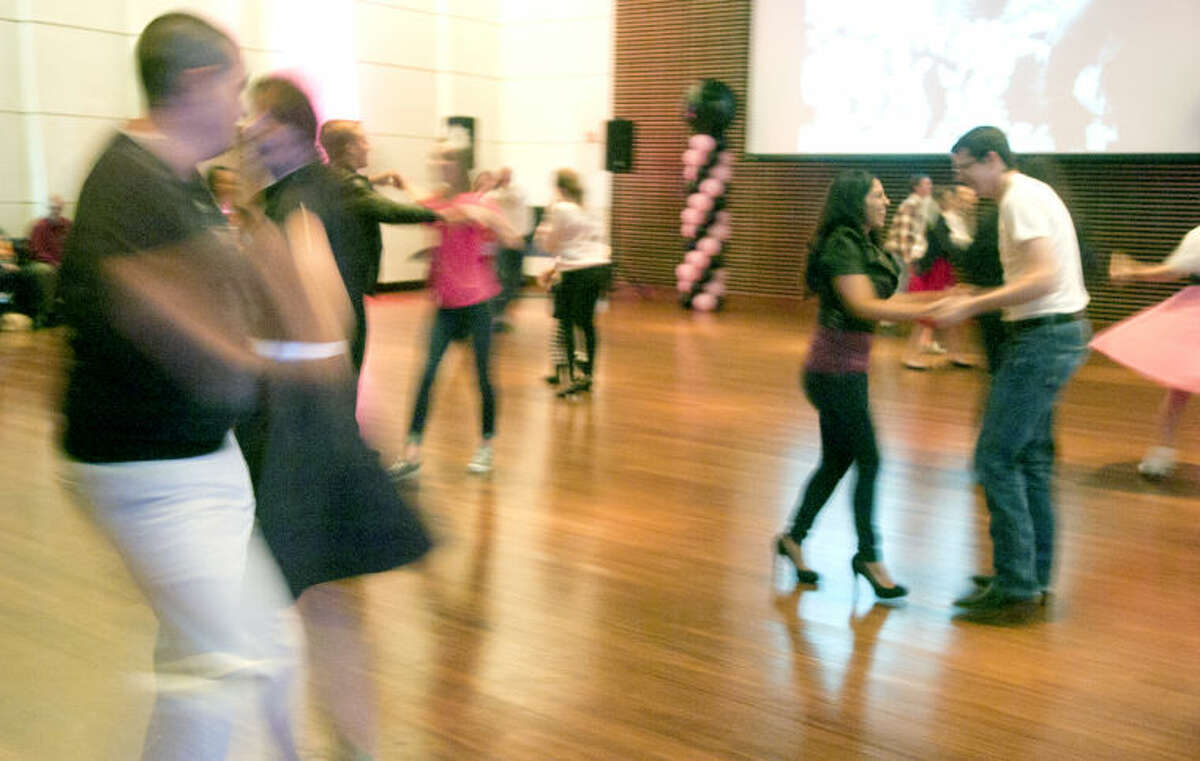 Participants dance during a sock hop put on by the Midland Symphony Orchestra & Chorale on Saturday at the Wagner Noel Performing Arts Center. A performance by the retro rock'n'roll band Flash Cadillac was part of the festivities as well. James Durbin/Reporter-Telegram