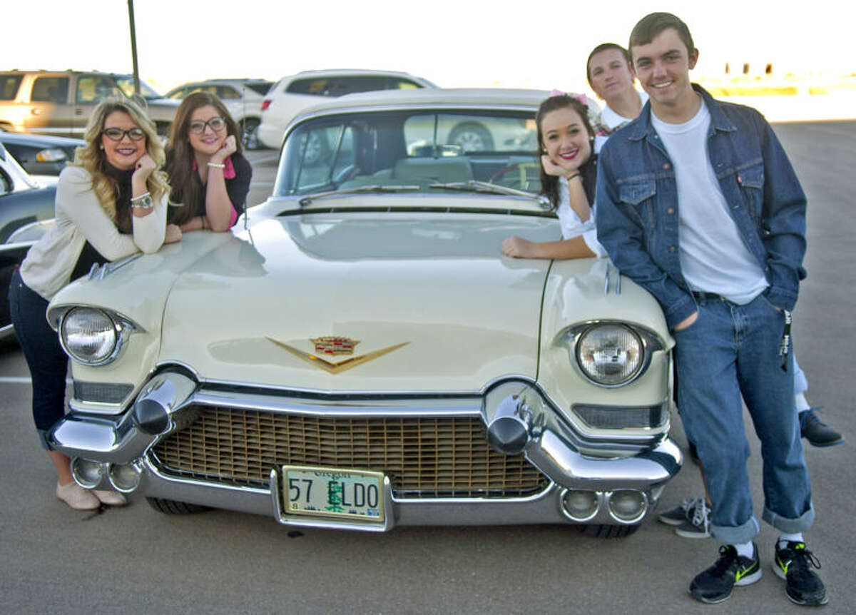 Symphony ushers dressed in 50's attire pose with a 1957 Cadillac El Dorado during a classic car show and sock hop put on by the Midland Symphony Orchestra & Chorale on Saturday at the Wagner Noel Performing Arts Center. A performance by the retro rock'n'roll band Flash Cadillac was part of the festivities as well. James Durbin/Reporter-Telegram
