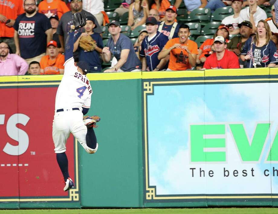 Houston Astros right fielder George Springer (4) catches a sacrifice fly by Cleveland Indians catcher Chris Gimenez (38) in the fifth. Game two of a three-game series between Houston Astros and Cleveland Indians on Tuesday, May 10, 2016, in Houston. Astros lead the series 1-0.  ( Elizabeth Conley / Houston Chronicle ) Photo: Elizabeth Conley, Staff / © 2016 Houston Chronicle