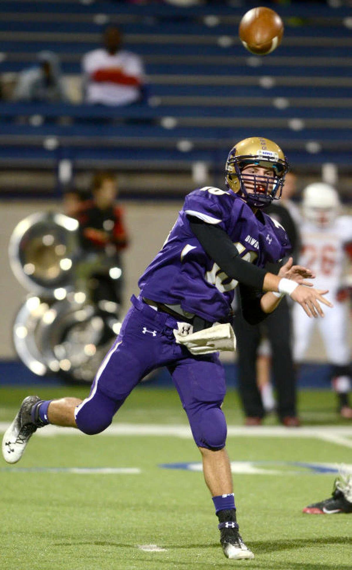Midland High quarterback Ryan Goodrum throws against Lubbock Coronado on Friday at Grande Communications Stadium. James Durbin/Reporter-Telegram