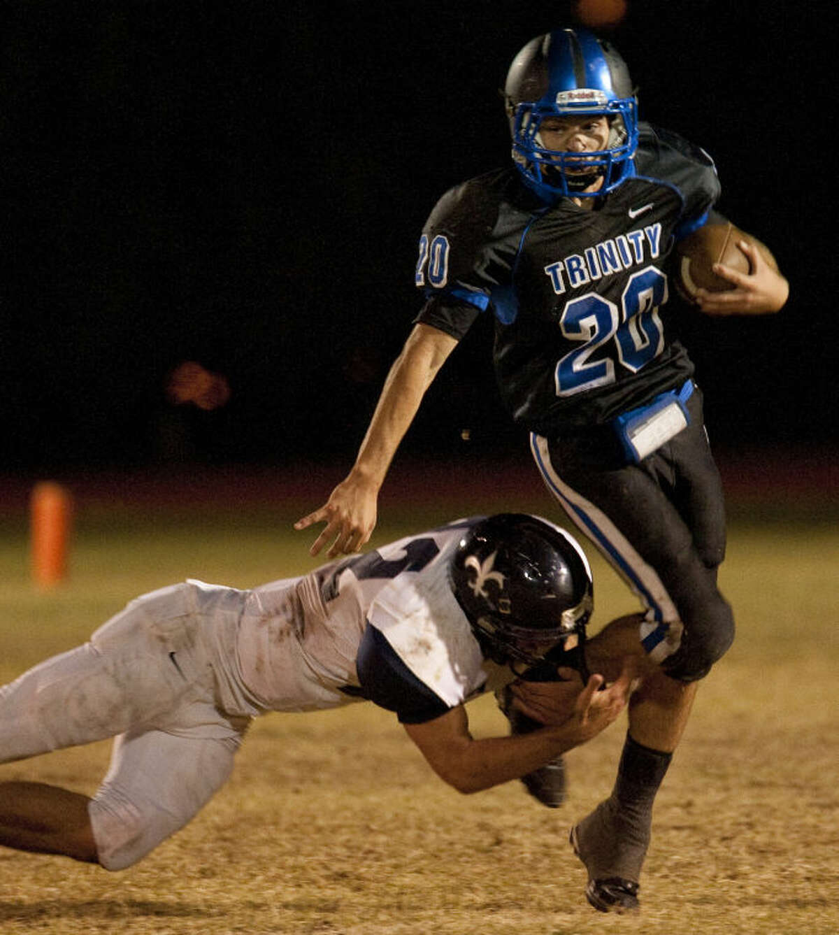Trinity's Vincent Baiano tries to get away from Carrollton Christian's David Niermann on Oct. 25 at Coombes Field. Tim Fischer\Reporter-Telegram