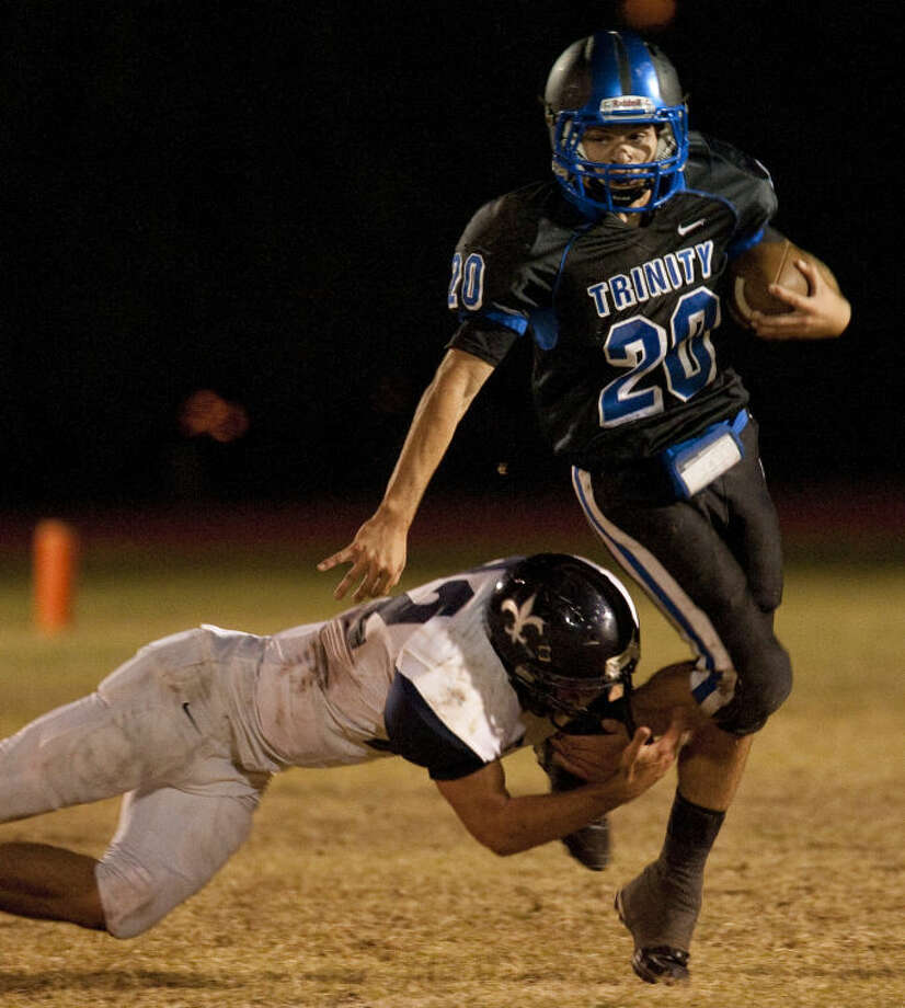 Trinity's Vincent Baiano tries to get away from Carrollton Christian's David Niermann on Oct. 25 at Coombes Field. Tim Fischer\Reporter-Telegram Photo: Tim Fischer