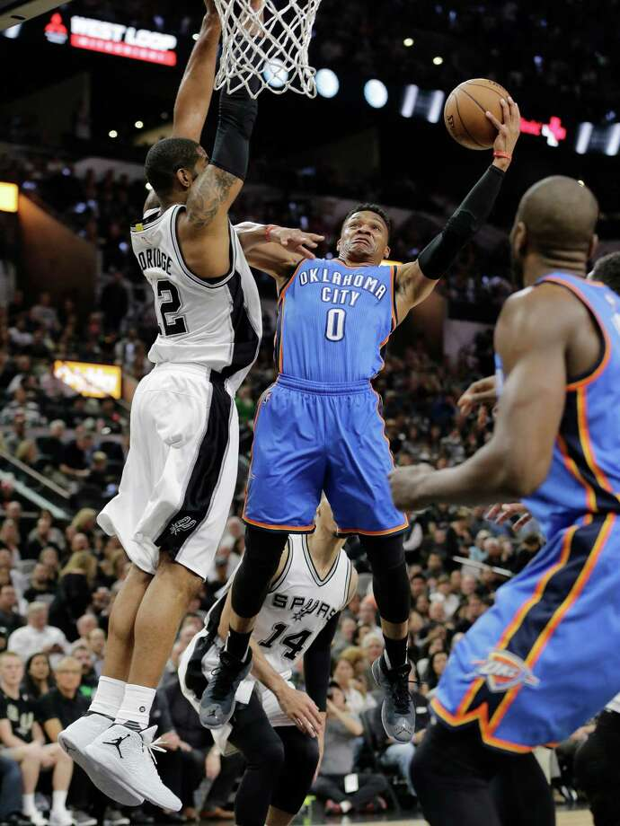 Russell Westbrook, who led the Thunder with 35 points, doesn't back down from the challenge by the Spurs' LaMarcus Aldridge. Photo: Eric Gay, STF / Copyright 2016 The Associated Press. All rights reserved. This material may not be published, broadcast, rewritten or redistribu