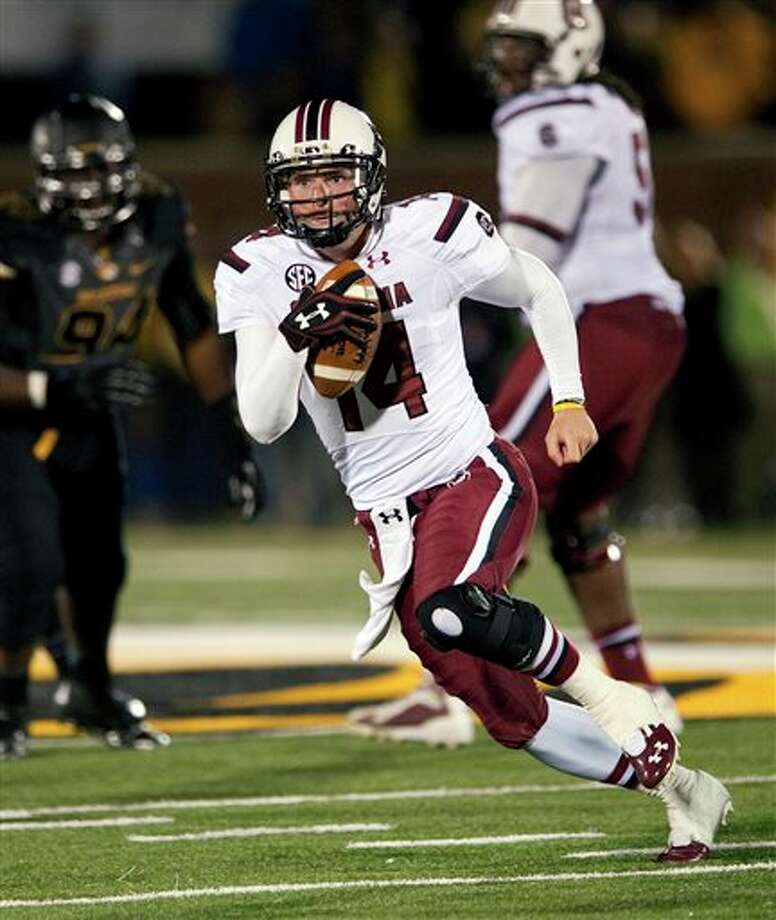 South Carolina quarterback Connor Shaw scrambles for yardage during the fourth quarter of an NCAA college football game against Missouri, Saturday, Oct. 26, 2013, in Columbia, Mo. South Carolina won 27-24. (AP Photo/L.G. Patterson) Photo: L.G. Patterson / FR23535 AP
