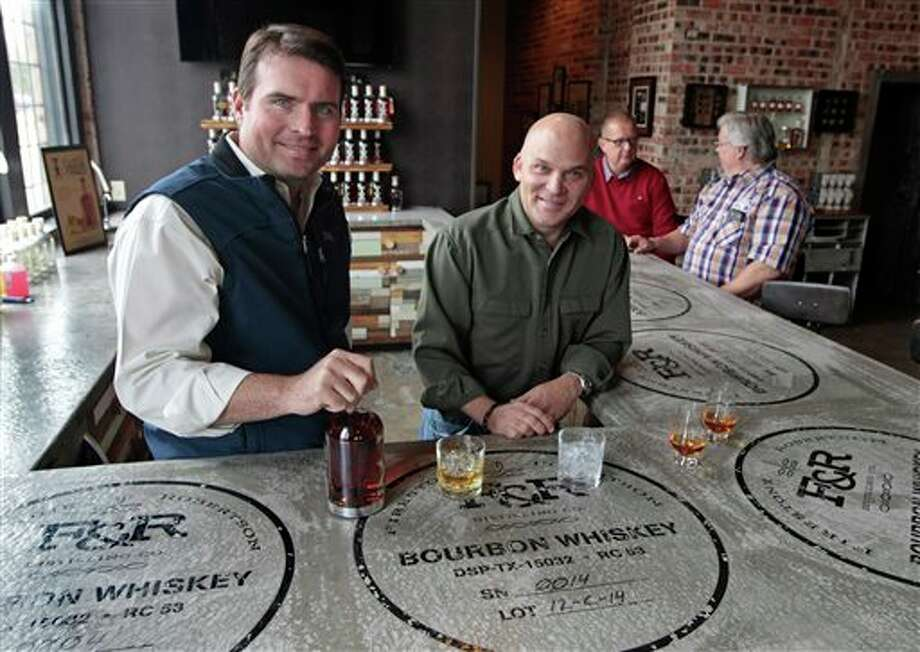 Troy Robertson, left, and Leonard Firestone of Firestone & Robertson Distilling posae in Fort Worth, Texas on Wednesday, October 16, 2013. A new regulation that allows craft distillers to sell their product by the drink and the bottle has helped their business. (Star-Telegram/Ron T. Ennis) (AP Photo/The Fort Worth Star-Telegram,Ron T. Ennis) MAGS OUT; (FORT WORTH WEEKLY, 360 WEST); INTERNET OUT Photo: RON T. ENNIS / The Fort Worth Star-Telegram