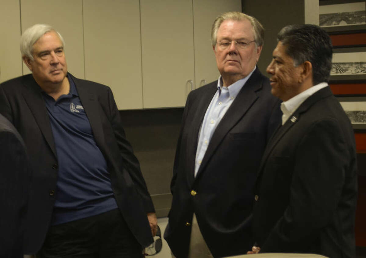 Steve Castle and Don Tomlin talk with Jerry Morales as they and other members of the Midland business community give their support to mayoral candidate Jerry Morales Monday during a press conference at Henry Resources. Tim Fischer\Reporter-Telegram