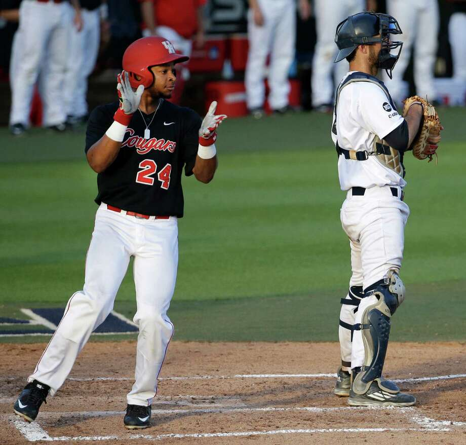 UH's Corey Julks, left, leads the cheers after scoring on a double by Conner Wong during the Cougars' three-run third inning Tuesday night. Julks contributed to another three-run outburst in the fourth with a two-run single. Photo: Melissa Phillip, Staff / © 2016 Houston Chronicle