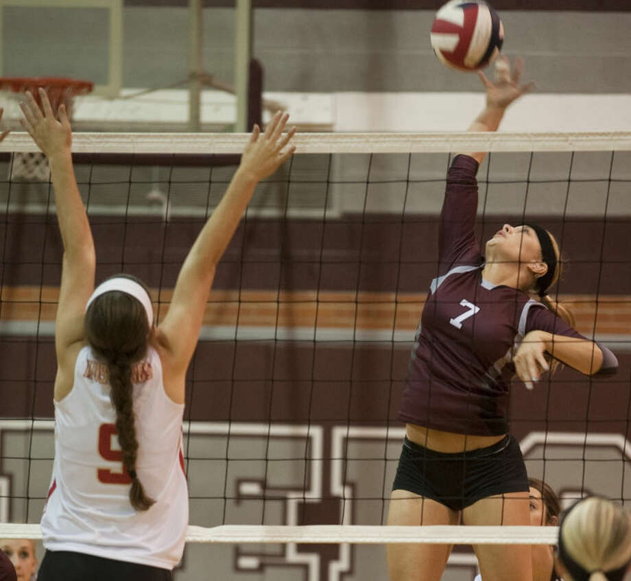 Lee's Ashley Carter gets up for a spike as Lubbock Coronado's McKaleigh Watson tries to block Oct. 22 at LHS gym. Tim Fischer\Reporter-Telegram Photo: Tim Fischer