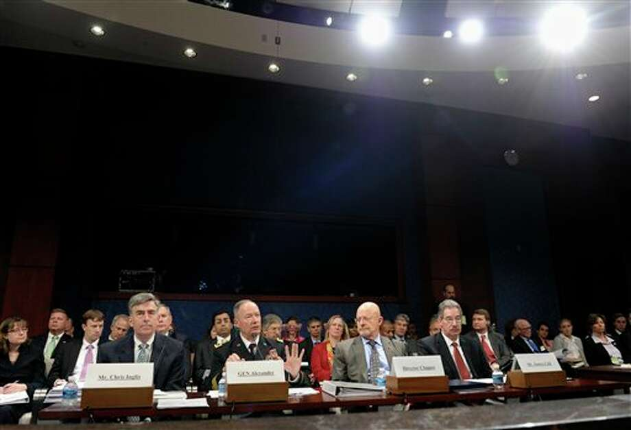 From left, National Security Agency Deputy Director Chris Inglis, National Security Agency director Gen. Keith Alexander, Director of National Intelligence James Clapper and Deputy Attorney General James Cole, testify on Capitol Hill in Washington, Tuesday, Oct. 29, 2013, before the House Permanent Intelligence Committee hearing on potential changes to the Foreign Intelligence Surveillance Act (FISA). Faced with anger over revelations about U.S. spying at home and abroad, members of Congress suggested Tuesday that programs the Obama administration says are needed to combat terrorism may have gone too far. (AP Photo/Susan Walsh) Photo: Susan Walsh / AP