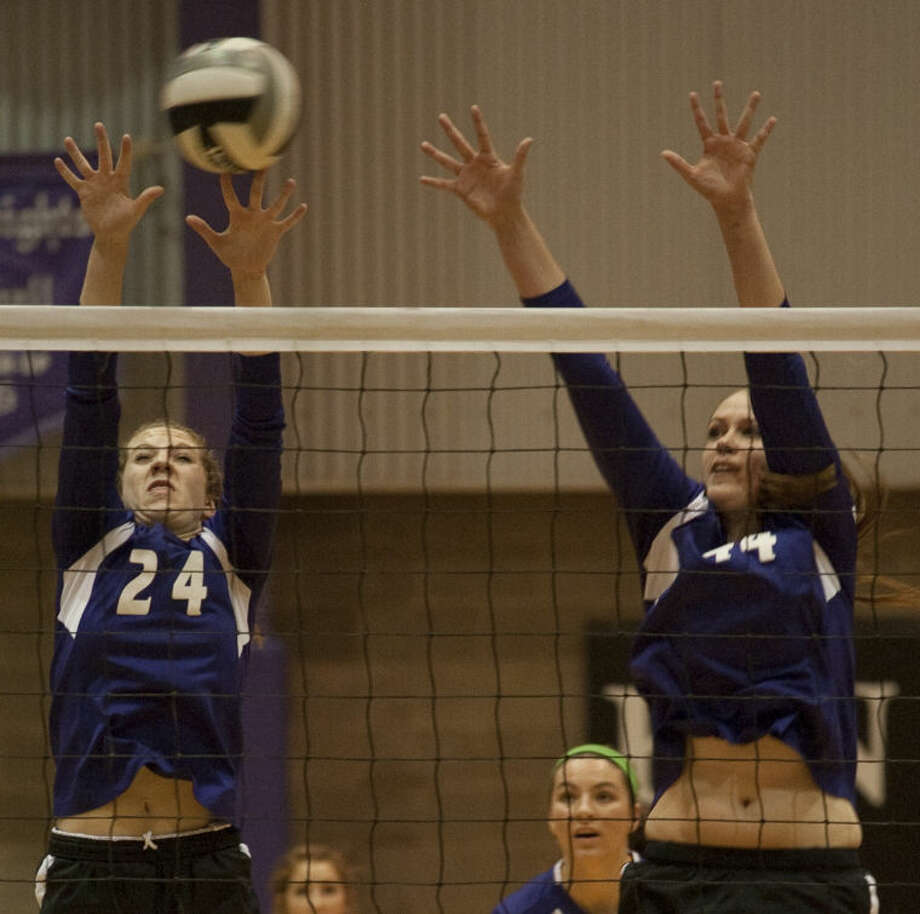 Midland Classical Academy's Alissa Beattie, 24 and Danilelle Jackson, 44, go up for a block Tuesday during a playoff match against Fort Worth Bethesda. Tim Fischer\Reporter-Telegram Photo: Tim Fischer