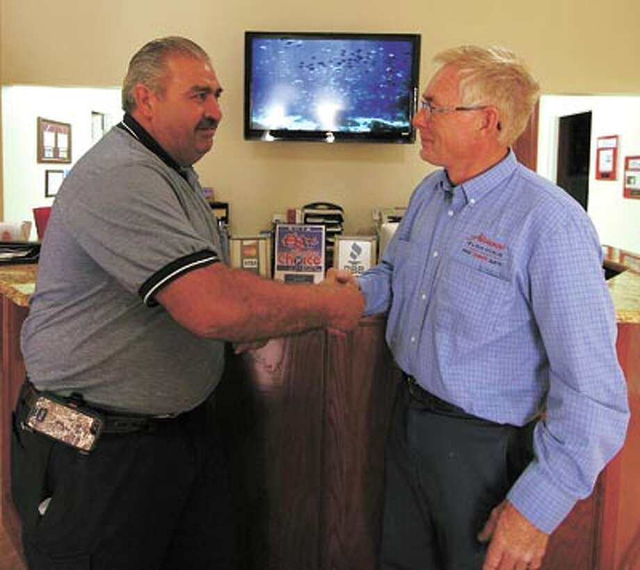 Advance Cleaning's Holman Padgett, right, welcomes longtime area expert Joe Balli to the staff. Call Advance Cleaning for help with fire or flood damage or for basic carpet and floor cleaning. Their phone number is 550-8325. Photo: Unknown