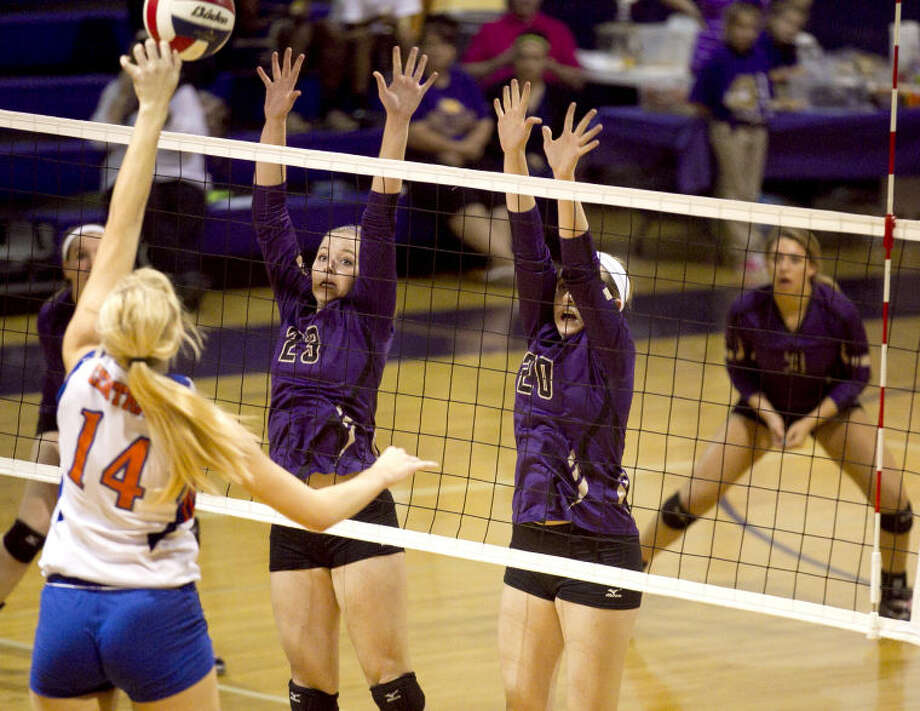 Midland High's Jenna Gillean (23) and Claire Lancaster (20) try to block a shot from San Angelo Central's Jordan Kohl (14) on Tuesday at Midland High. James Durbin/Reporter-Telegram Photo: JAMES DURBIN