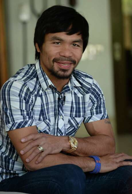 Philippine boxing legend Manny Pacquiao gestures during an interview at his residence in Manila on April 28, 2016. Pacquiao expressed shock on April 28 at President Benigno Aquino's claim that Islamic militants planned to kidnap him, and said the alleged plot should not have been made public. / AFP PHOTO / TED ALJIBETED ALJIBE/AFP/Getty Images Photo: TED ALJIBE, Stringer / AFP or licensors