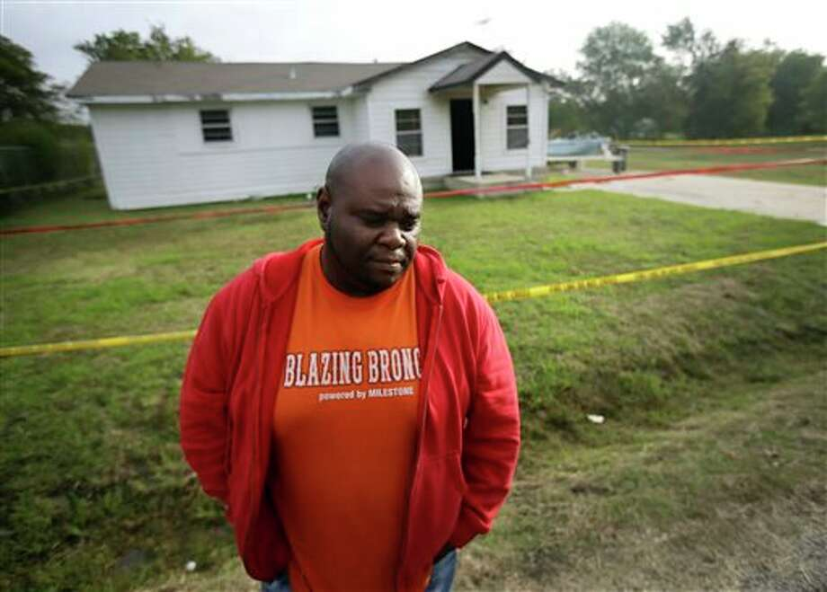 FILE - In this Tuesday, Oct. 29, 2013 file photo, Terrence Walker of Forney, Texas, the brother of 36-year-old Charles Everett Brownlow Jr., stands in front of the house of their mother, Mary Brownlow, as he answers a reporter's question in Terrell, Texas. Police arrested Charles Everett Brownlow Jr. early Tuesday, suspected of killing his mother and his aunt and 3 other people during a series of attacks hours earlier in this rural North Texas community. (AP Photo/Tony Gutierrez) Photo: Tony Gutierrez / AP