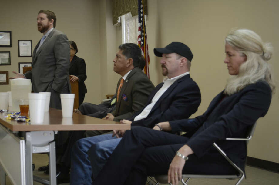 Mayoral candidate Dan Anderson speaks Thursday as John James, Jerry Morales, Keith McLennad and Kathy White wait to speak at the Permian Basin Apartment Association meeting. Tim Fischer\Reporter-Telegram Photo: Tim Fischer