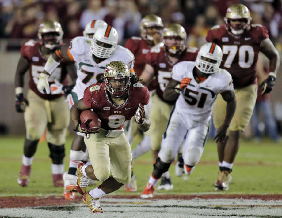 Florida State running back Devonta Freeman (8) outruns the Miami defense during the third quarter of an NCAA college football game Saturday, Nov. 2, 2013, in Tallahassee, Fla. (AP Photo/Chris O'Meara) Photo: Chris O'Meara