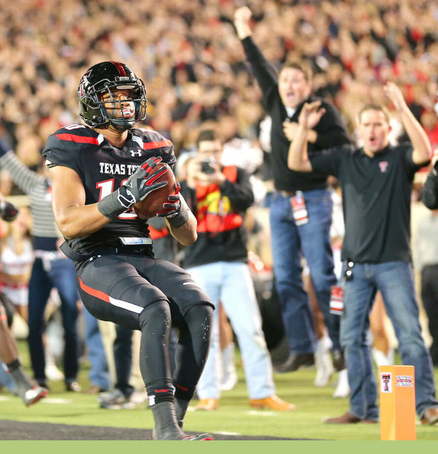 Texas Tech defender Pete Robertson crosses the goal line after returning an interception for a touchdown in Saturday nights Big XII action againt Oklahoma State. Photo: Wade H Clay