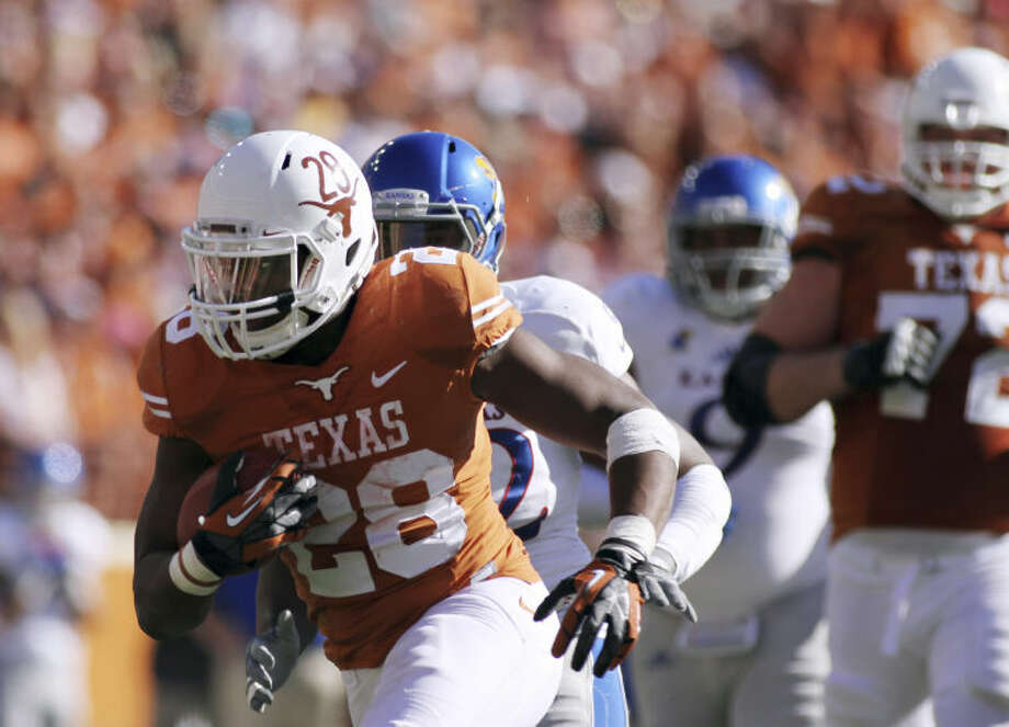 Texas' Malcolm Brown runs with the ball against Kansas during an NCAA college football game Saturday, Nov. 2, 2013, in Austin, Texas. Texas won 35-13. (AP Photo/The Daily Texan, Shelby Tauber) Photo: Shelby Tauber