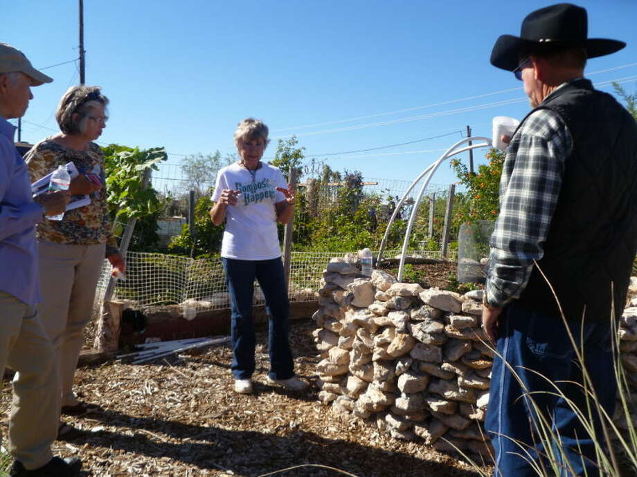 Master Gardener Mary Ann Miles demonstrates how to make a keyhole garden Saturday at a winter gardening workshop held by the Master Gardeners of the Permian Basin.