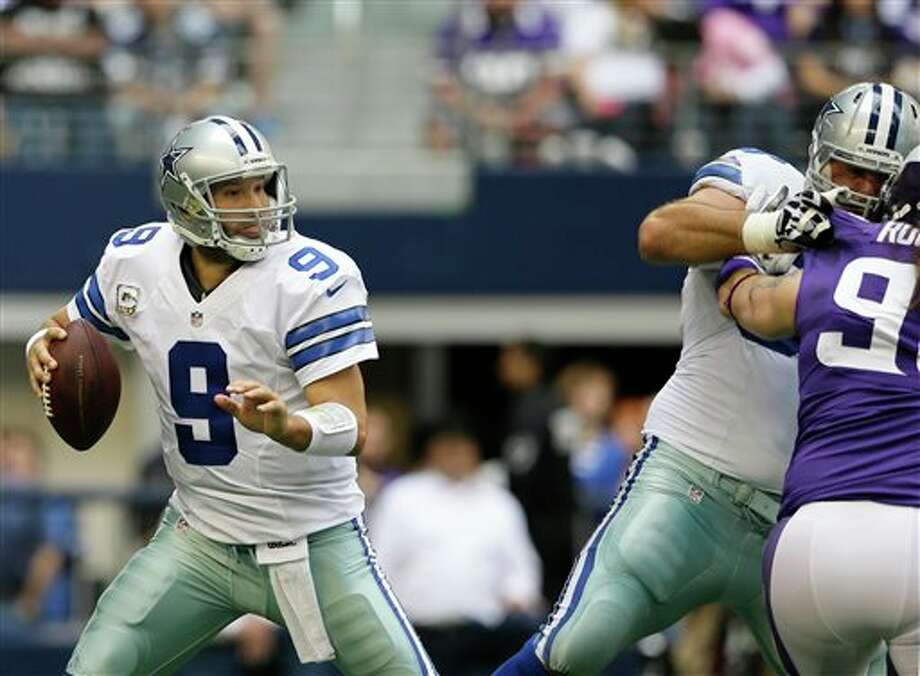Dallas Cowboys quarterback Tony Romo (9) throws a pass in the first half of an NFL football game against the Minnesota Vikings Sunday, Nov. 3, 2013, in Arlington, Texas. (AP Photo/Tim Sharp) Photo: Tim Sharp / FR62992 AP