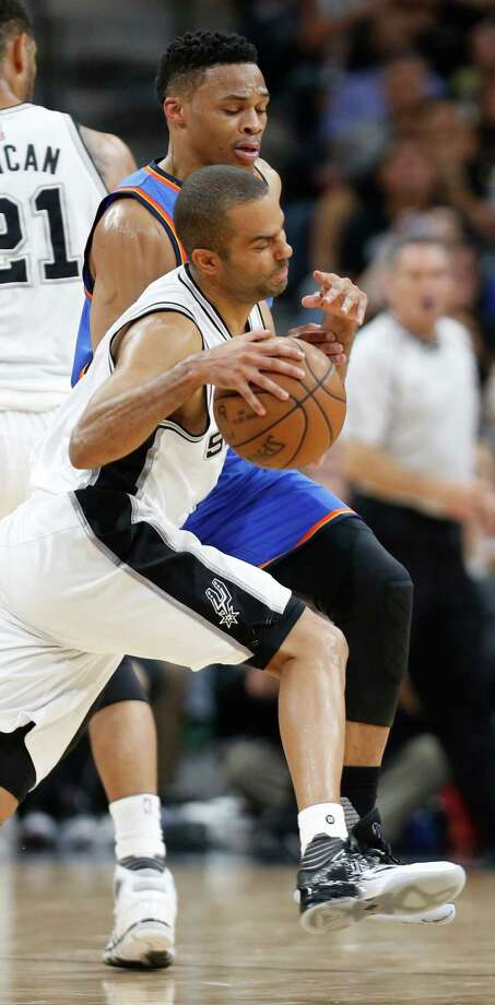 SAN ANTONIO,TX - MAY 10:  Tony Parker #9 of the San Antonio Spurs is fouled by Russell Westbrook #0 of the Oklahoma City Thunder  in game Five of the Western Conference Semifinals during the 2016 NBA Playoffs at AT&T Center on May 10, 2016 in San Antonio, Texas.  NOTE TO USER: User expressly acknowledges and agrees that , by downloading and or using this photograph, User is consenting to the terms and conditions of the Getty Images License Agreement. Photo: Ronald Cortes, Getty Images / 2016 Getty Images
