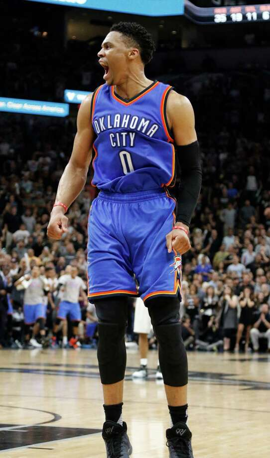 SAN ANTONIO,TX - MAY 10: Russell Westbrook #0 of the Oklahoma City Thunder reacts after scoring against the San Antonio Spurs in closing seconds in game Five of the Western Conference Semifinals during the 2016 NBA Playoffs at AT&T Center on May 10, 2016 in San Antonio, Texas.  NOTE TO USER: User expressly acknowledges and agrees that , by downloading and or using this photograph, User is consenting to the terms and conditions of the Getty Images License Agreement. Photo: Ronald Cortes, Getty Images / 2016 Getty Images