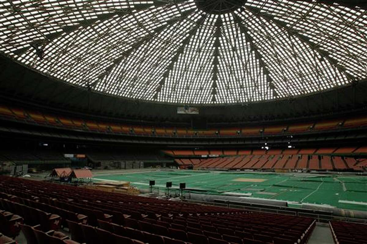 FILE- In this May 21, 2012 file photo, the Astrodome sits gathering dust and items for storage in Houston. A coalition of local and national preservation groups is taking its efforts to save the iconic but now shuttered Houston Astrodome to the streets. On Tuesday, Nov. 5, 2013, voters will decide whether to approve a referendum authorizing up to $217 million in bonds to turn the stadium that once hosted both baseball and football games into a giant convention center and exhibition space.(AP Photo/Pat Sullivan, File)